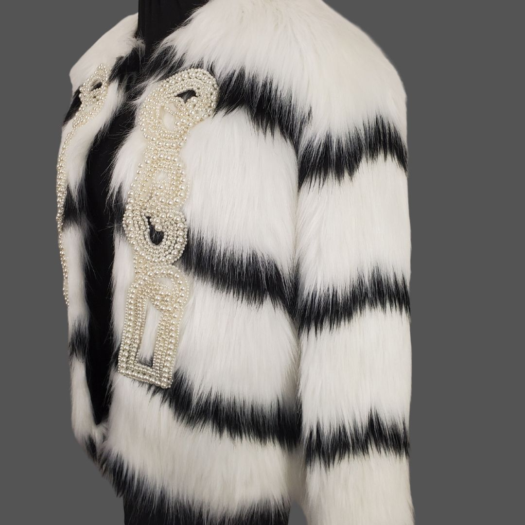black and white faux fur coat with pearls side view open on dress form