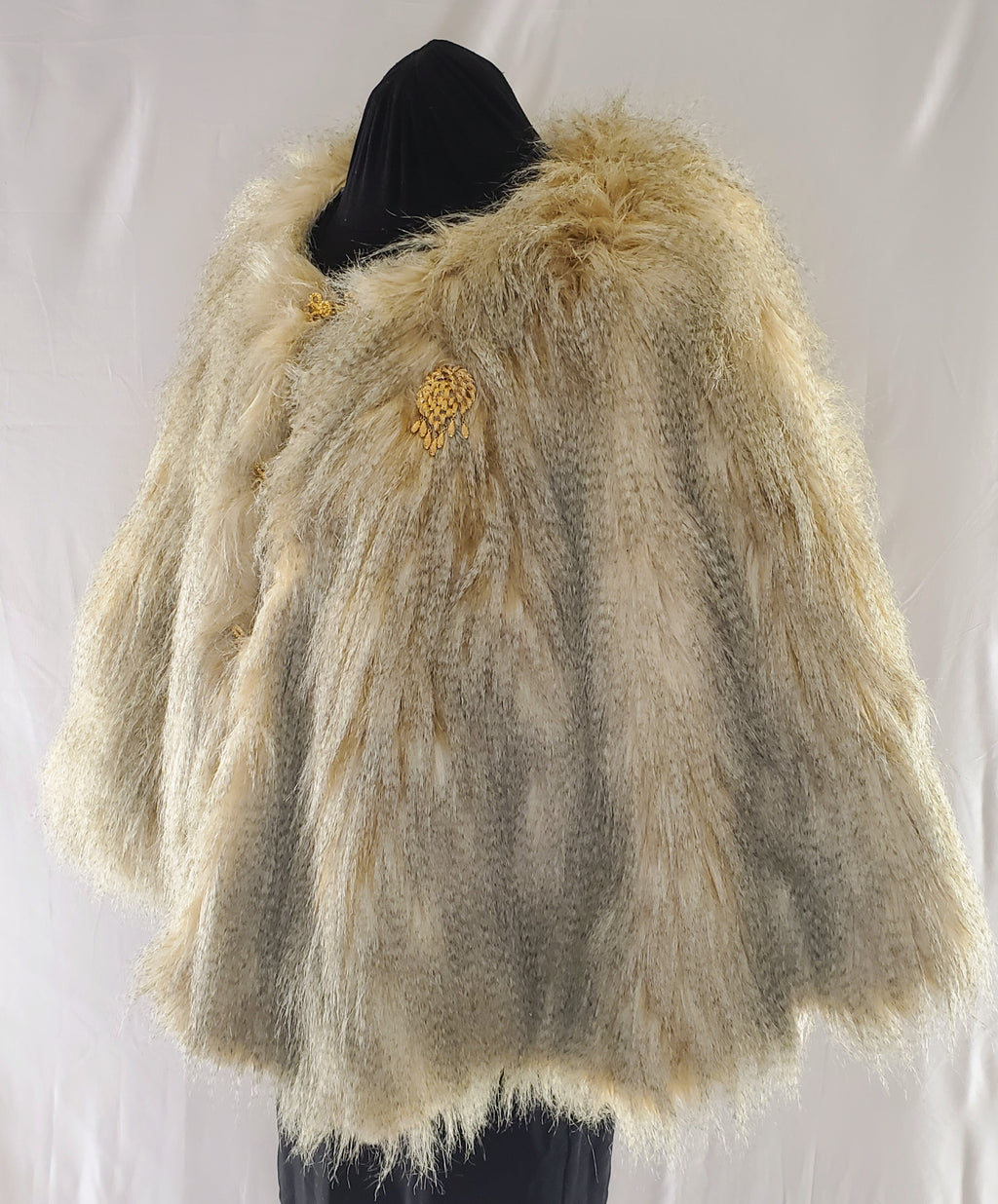 Gold and Tan Faux Fur Cape with vintage gold clasps and broach side view closed
