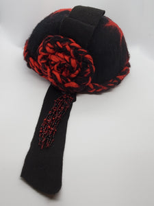 red and black felt cloche with bead tassel