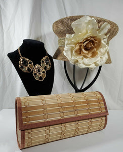 Beige wood slat clutch with golden abstract cloche accented with large cream flower and black rhinestone and gold chunky necklace.