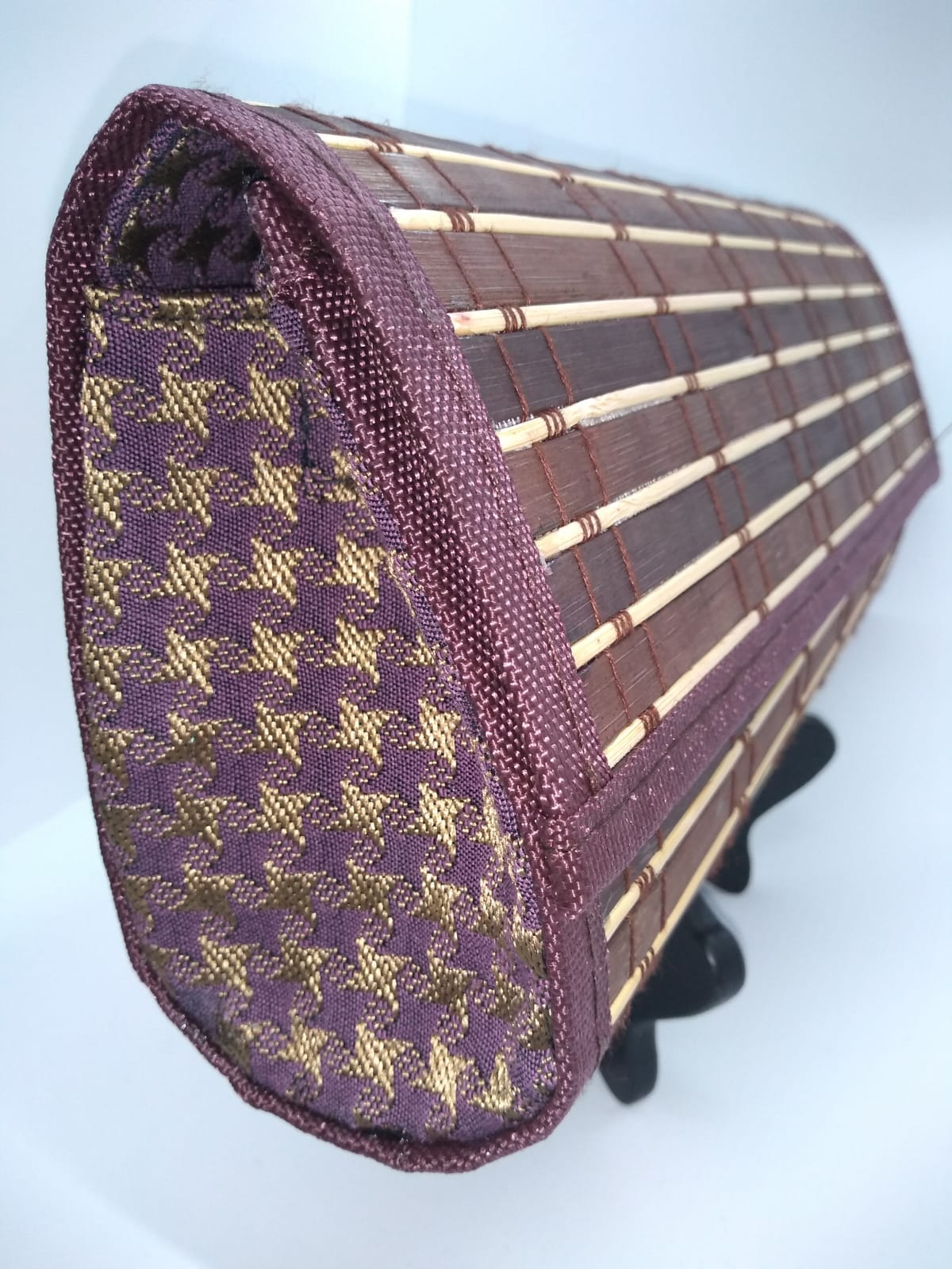 Side view of brown wood clutch with purple and gold hounds tooth side panels