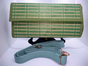 Green wood clutch with turquoise strap