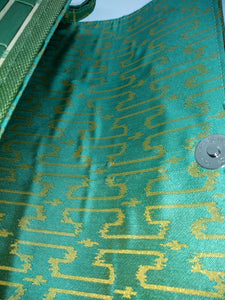 turquoise and gold brocade lining of green wooden slat clutch