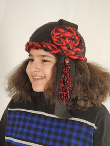 red and black cloche with bead tassel on female model