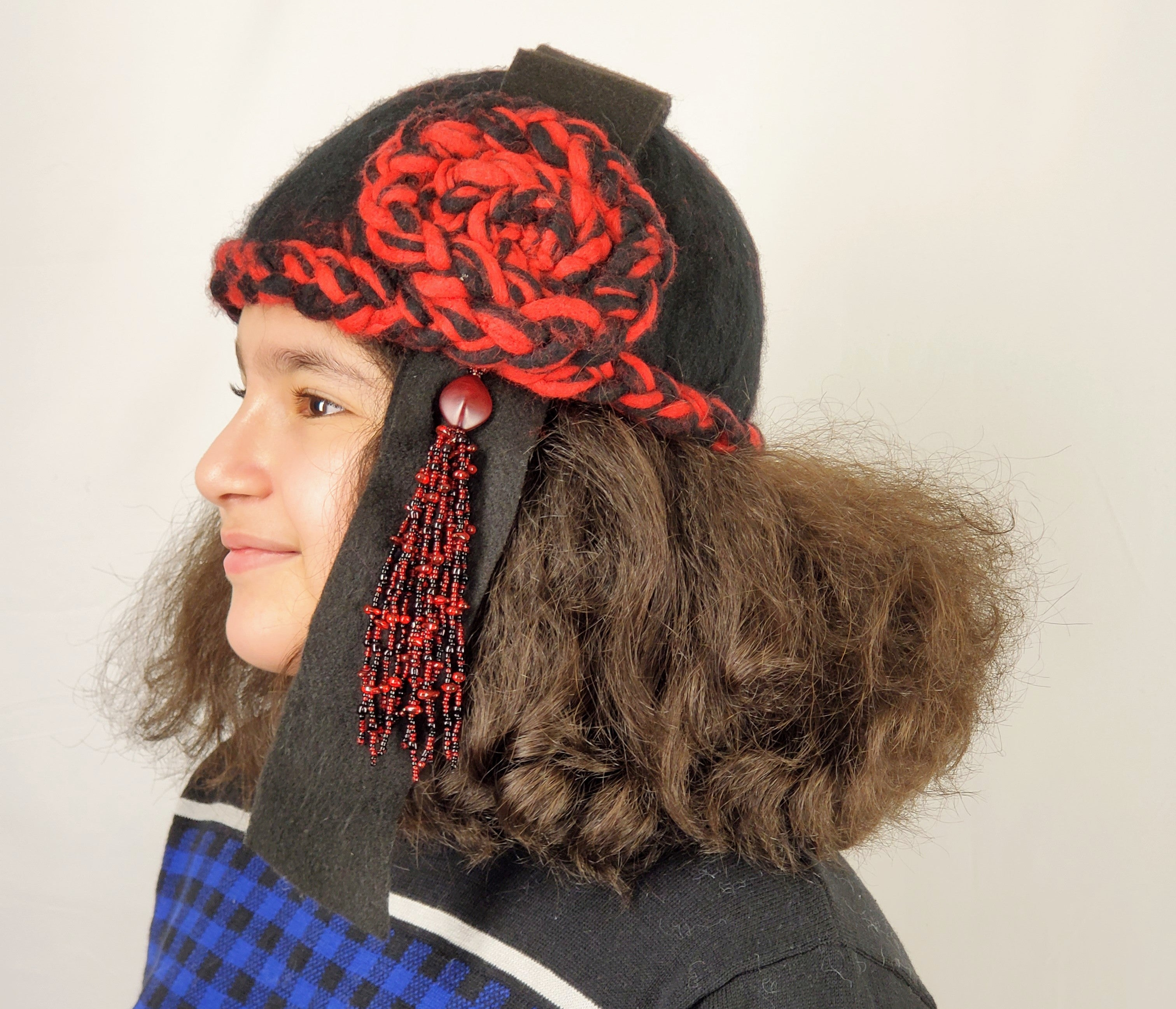 red and black cloche with bead tassel on female model side view