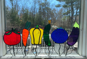 A selection of whimsical stained glass rainbow vegetable gardens