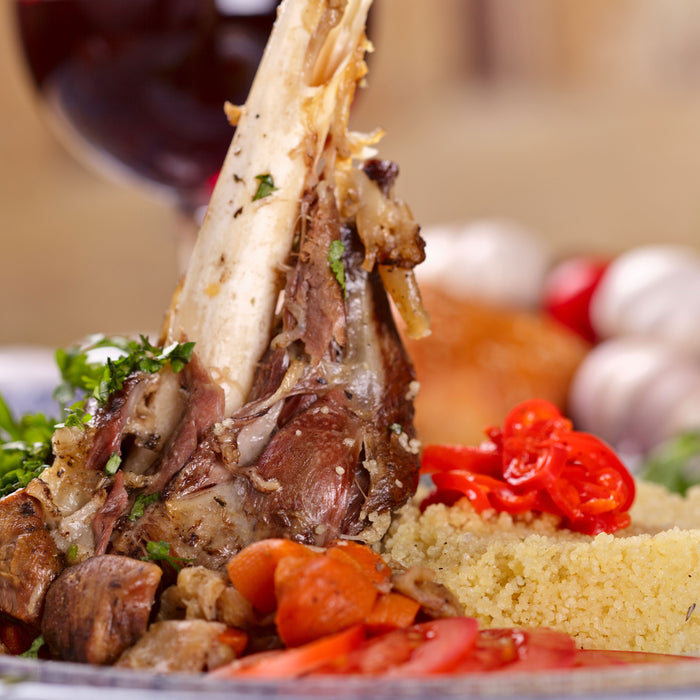 Braised Moroccan Lamb Shanks with Apricot Almond Couscous