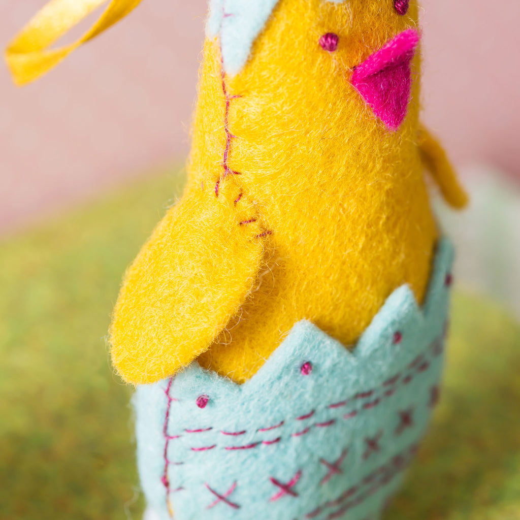 This gorgeous Chick in his Egg craft kit from Corinne Lapierre contains everything you need to make one felt hanging decoration.