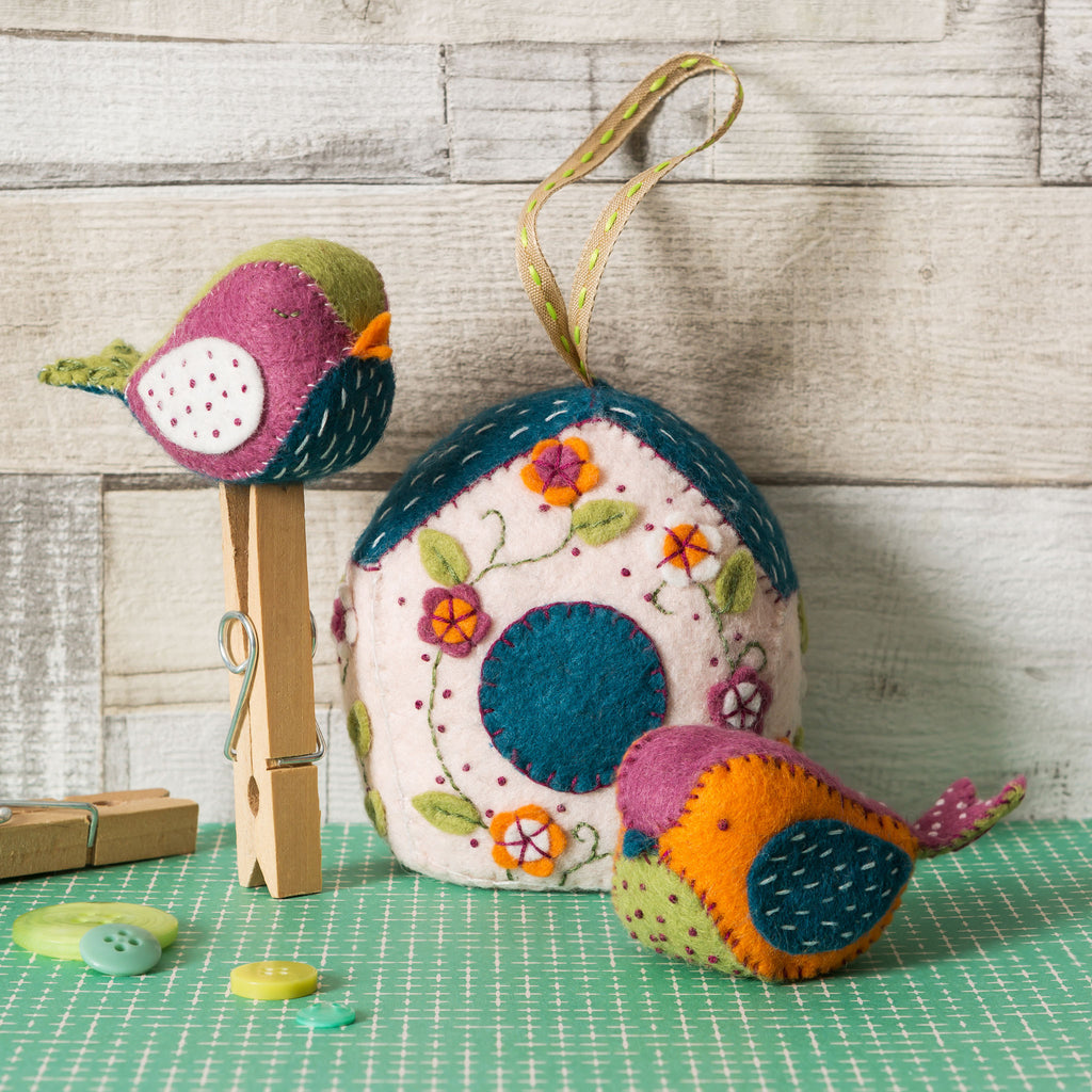 This kit contains everything you need to make a blossom covered Birdhouse and two chirpy Birds.  Felt craft kit with embroidery and appliqué.
