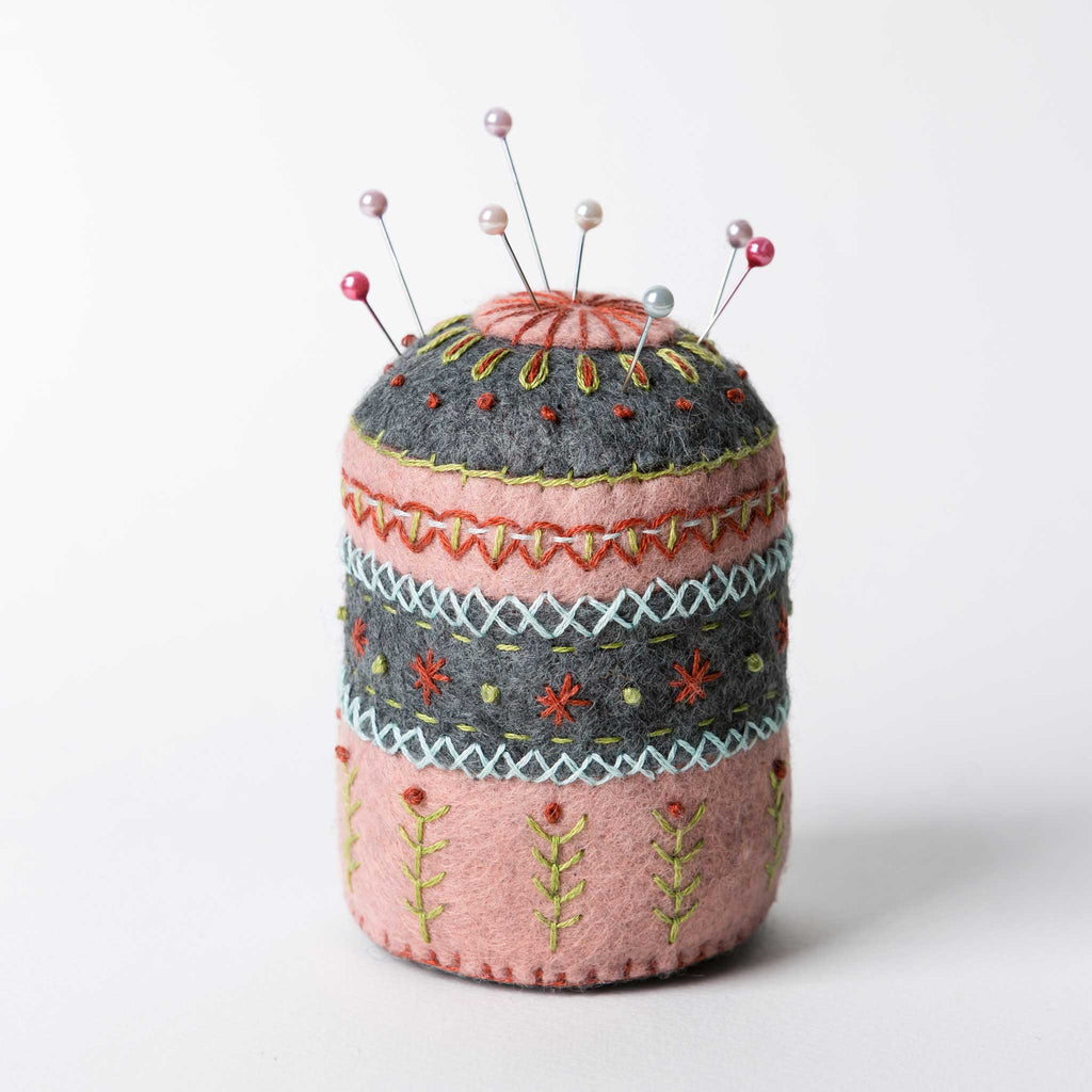 Corinne Lapierre's felt Pin Cushion is a must have for all crafters of all abilities. With its subtle vintage colours and delicate folk-inspired embroidery, it is as beautiful as it is useful.  Corinne has sought inspiration from traditional folk designs which are so pleasing to the eye and have timeless appeal.