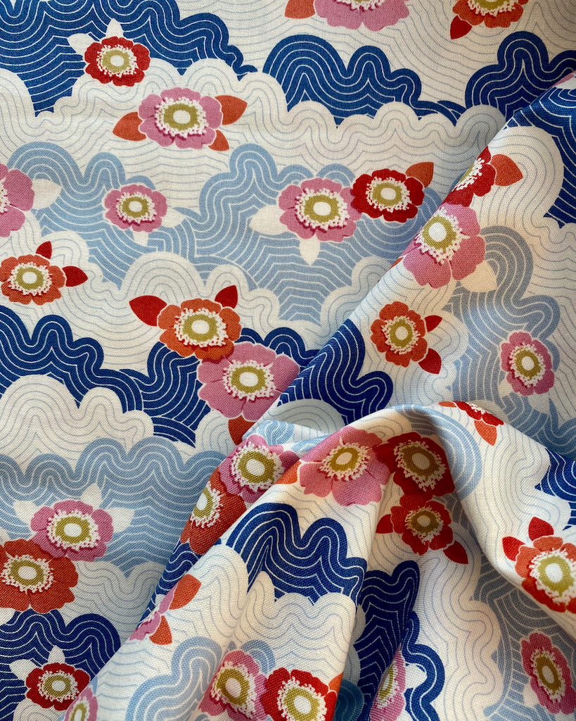 "Tilda LazyDays Frances Blue Cotton Fabric.  This beautiful Tilda fabric is from the LazyDays collection.  It is a lovely pattern of blues and whites with red flowers.  It feels quite 1920ish!  🧵It is a medium weight quilting 100% cotton fabric and is perfect for crafts, dressmaking or home decorating projects such as cushions and bunting. The width is 44""/112cm.  It is suitable for hand washing and machine washing."