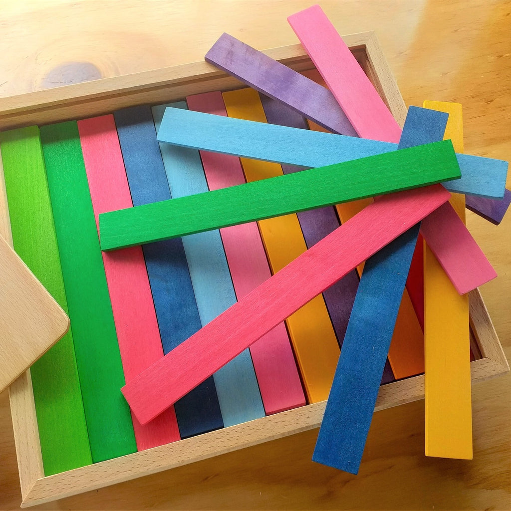 Bauspiel coloured rods in open box with spread
