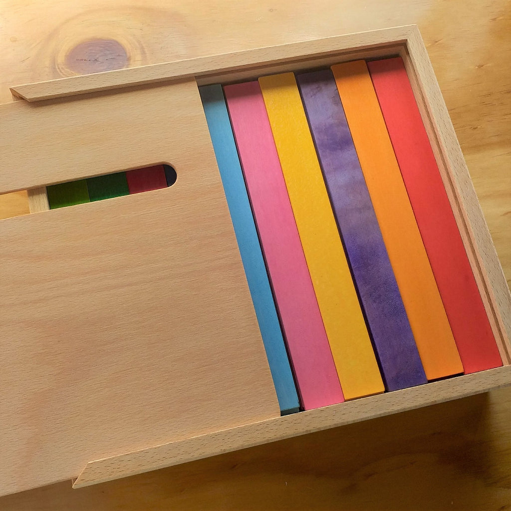 Bauspiel coloured rods in half open box