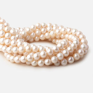 8.5x8-9.5x9mm Off White Off Round freshwater pearls 16 inch 47 pieces - Beadsofcambay.com