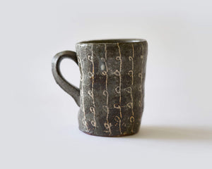 Mug with coiled cable pattern by Scott Brough