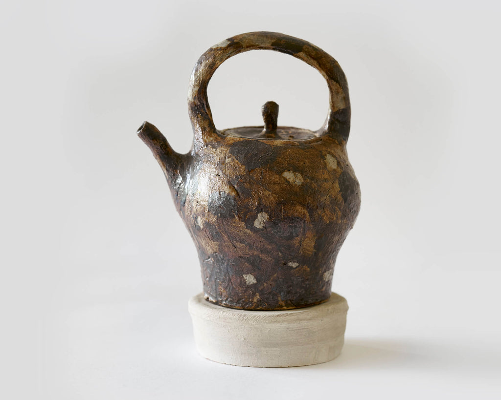 Brown Teapot with stand by Scott Brough