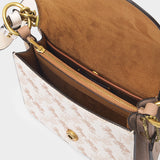 Horse and Carriage Coated Canvas Beat Shoulder Bag 18 in Chalk Taupe