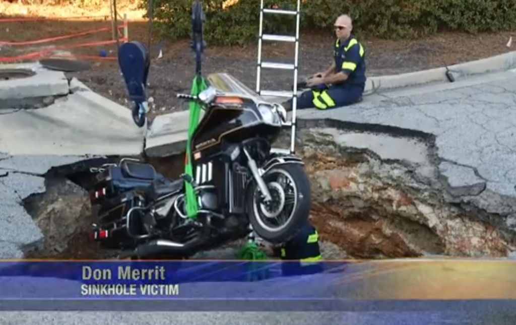 Sinkhole In Shopping Center Swallows Man and Motorcycle; Victim Might Not Be Compensated