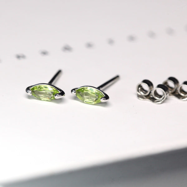 Side view of Bena Jewelry studs earrings green peridot natural gemstone for Ruby Mardi boutique Little Italy Saint Zotique Fine Jeweler Montreal Made in Canada