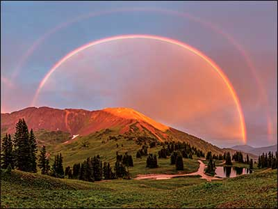Rainbow Stretching Across Mountain