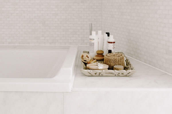 modern bathroom design with skincare and loofah