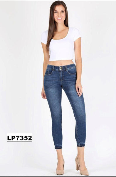 Wide waist skinny medium blue denim with released hem