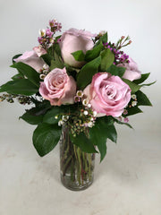 Pink Classic Designed Roses using seasonal greens and accents of waxflowers or seeded eucalyptus.