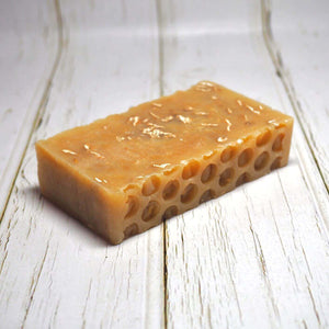 Naturally made Cotswold honey and oat soap with visible oats for better cleaning