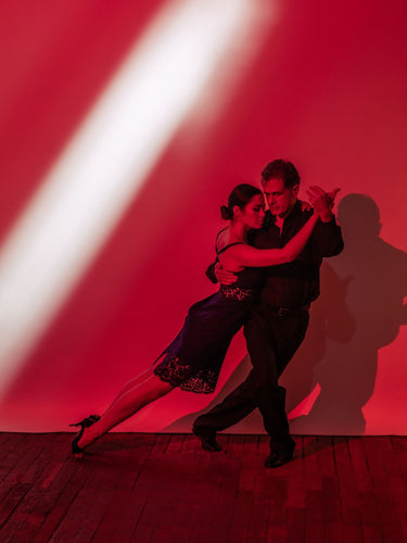 Argentine Tango pose- volcada red background