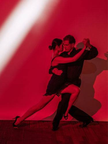 Argentine Tango pose- leg wrap red background