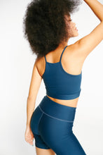 Load image into Gallery viewer, ro/an navy moringa back shot with nelli short