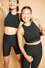 Load image into Gallery viewer, ro/an goji bra group shot black front size M worn with matcha legging