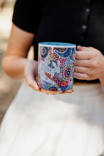 These Wiradjuri Art standard sized coffee mugs come printed with the Kangaroo Dreaming 2 artwork. The mug can be purchased in the colour options of blue, pink, yellow or black for the handle and inside. Indigenous Art Aboriginal Art First Nations Art
