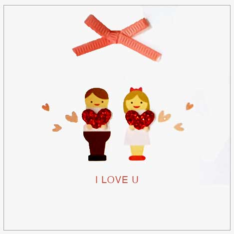 boy and girl each holding a red heart