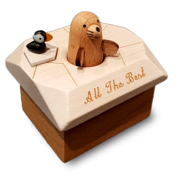 little brown seal and puffin musical box