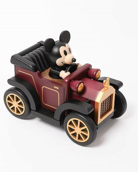 disney mickey enjoying a ride in a classic car