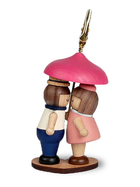 wooden memo clip boy kissing girl