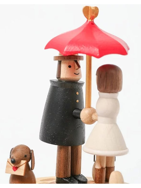 red umbrella couple with dog