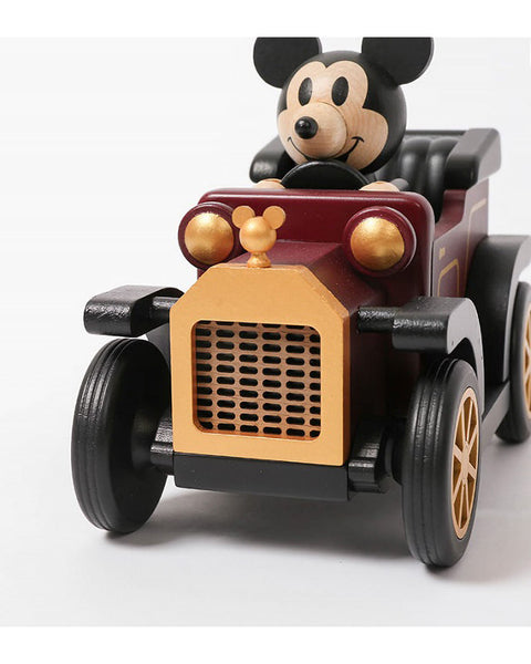 mickey mouse enjoying a drive in a classic car