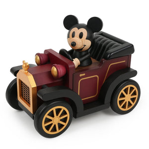 mickey in a burgundy classic car