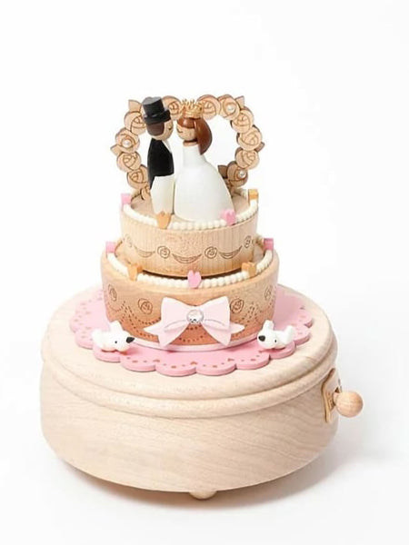 bride and groom on top of wedding cake