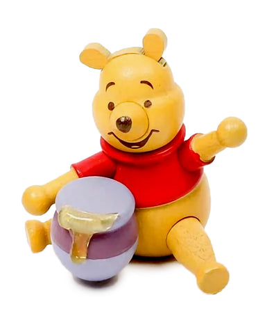 winnie the pooh with a tub of honey