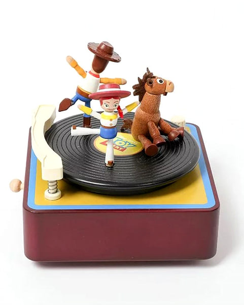 woody jessie and bullseye playing on a phonograph