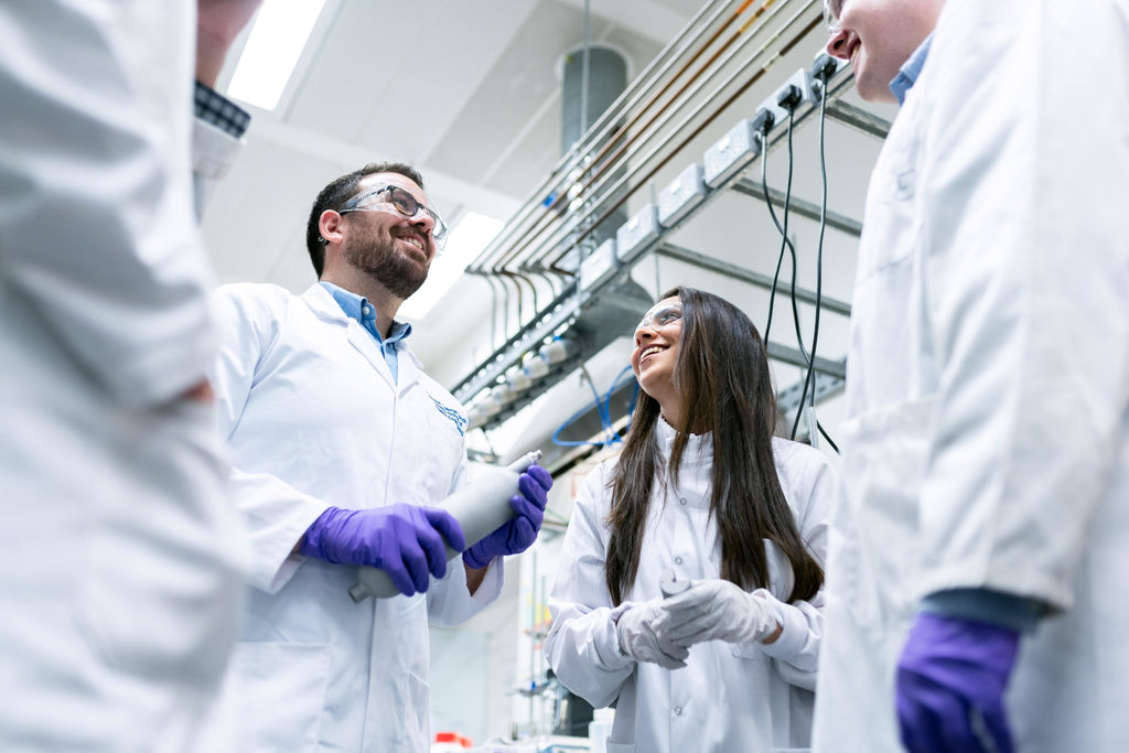 Image of scientists protected by their lab coats