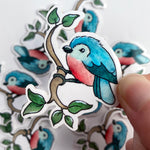 Vinyl sticker of a cute little blue bird. An original Found and Lost Art design by artist Christine Jamieson