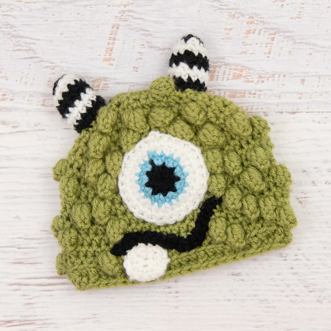 In-Stock 6-12 Month Little Monster in Dusty Green with Baby Aqua Eye.