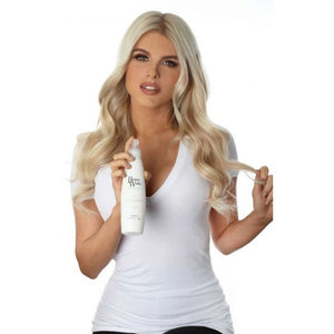 Model holding Beauty Works Heat Protection Spray