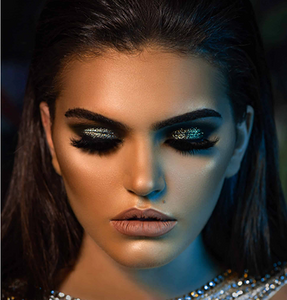 Model wearing smokey glittery eyes using bPerfect X JAH CLIENTELE PIGMENTS