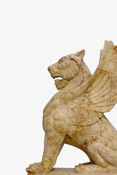 lion statue with wings