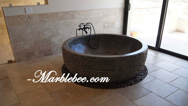 Brown marble bathtub round